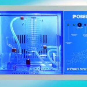 Destilador automático de agua, de vidrio en cabina metáliC