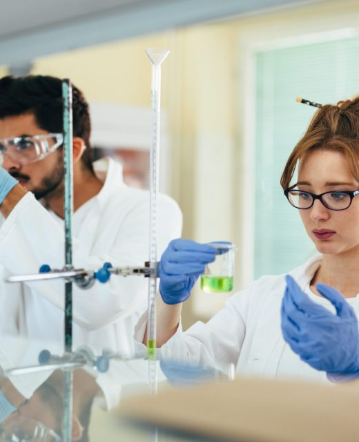 Gropu of scientist working at the laboratory